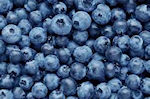 blue berries in green powder superdrink